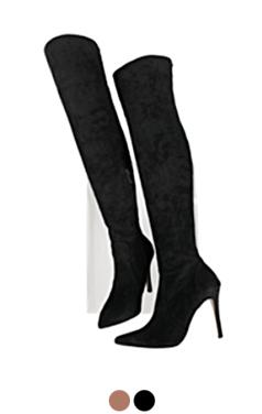 女性大腿的高筒靴